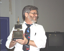 Dr. Paul Shuch holding the 2000 Bruno Award